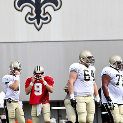 July 28, 2012; Metairie, LA, USA; New Orleans Saints quarterback Drew Brees (9) breaks from the huddle during a training camp practice at the team's indoor practice facility. Mandatory Credit: Derick E. Hingle-US PRESSWIRE