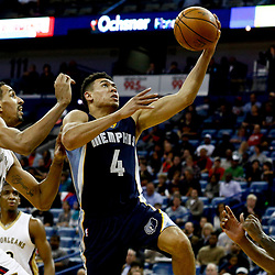 Dec 5, 2016; New Orleans, LA, USA; Memphis Grizzlies guard Wade Baldwin IV (4) shoots over New Orleans Pelicans center Alexis Ajinca (42) during the first quarter of a game at the Smoothie King Center. Mandatory Credit: Derick E. Hingle-USA TODAY Sports