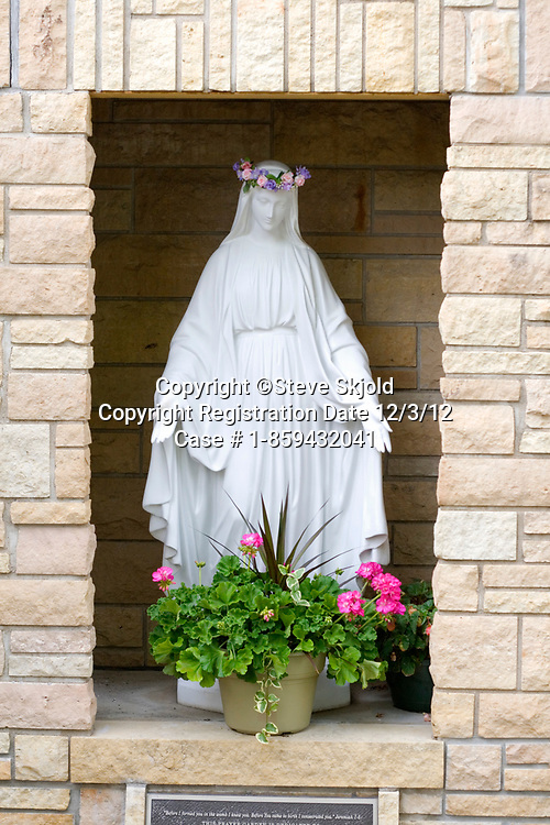Statuette of Virgin Mary in Catholic Church outdoor foyer. Minneapolis Minnesota MN USA