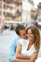 Man hugging girlfriend on street in Rome Italy front view