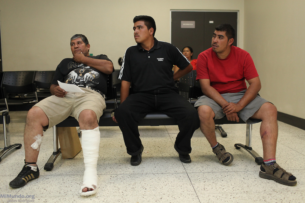 Artemio Humberto Castillo (left), 48, Wilmer Perez Martinez (center), 17, and Erick Castillo, 27, all from San Rafael Las Flores, wait at the Public Prosecutors Office in Guatemala City to denounce the shooting perpetrated against them and three others by the Escobal Project's security personnel. The six men were walking towards a peaceful protest camp rejecting the mining project on Saturday, April 27, 2013, when head security chief Alberto Rotondo, a Chilean citizen, ordered the shooting. Rotondo was later captured at the Aurora Airport attempting to escape the arrest warrant issued against him. Meanwhile, the official signing between the Guatemalan Government and Tahoe Resources & Goldcorp's El Escobal Silver mine went ahead as scheduled on April 29th. Guatemala City, Guatemala. April 29, 2013.