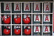 ANAHEIM, CA - AUGUST 2:  Closeup photo of batting helmets and gloves in dugout bins before the Los Angeles Angels of Anaheim game against the Toronto Blue Jays on Friday, August 2, 2013 at Angel Stadium in Anaheim, California. The Angels won the game 7-5. (Photo by Paul Spinelli/MLB Photos via Getty Images)