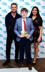 Michael Pearce and Rhianna Dillon present Frankie with the Film Reviewer of the Year award during the fifth annual Into Film Awards, held at the Odeon Luxe in Leicester Square, London.