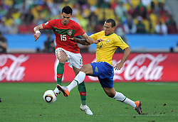 PEPE and LUIS FABIANO fight for the ball during the 2010 FIFA World Cup South Africa Group G match between Portugal and Brazil at Durban Stadium on June 25, 2010 in Durban, South Africa.