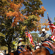 Members of the California Cowgirls head to their barn past a colorful maple tree after performing in the Equine Village Arena during the Alltech FEI World Equestrian Games at the Kentucky Horse Park on Thursday, October 7, 2010. Photo by David Stephenson