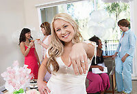 Bride Showing Off Ring at Bridal Shower