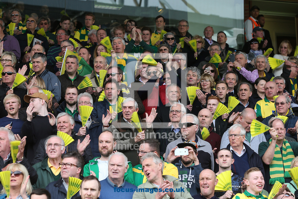 The home fans with their clappers before the Barclays Premier League match at Carrow Road, Norwich<br /> Picture by Paul Chesterton/Focus Images Ltd +44 7904 640267<br /> 02/04/2016