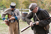 Arkansas, AR, USA, Old Washington State Park, Civil War Weekend. Confederate soldiers preparing for battle,