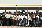 Journalists wait for the arrival of Ghana's new president John Atta Mills in Accra, Ghana on Wednesday January 7, 2009.