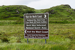 Traffic sign in north west Scotland with tourist advice to North Coast and West Coast