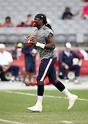 Houston Texans linebacker Jadeveon Clowney (90) laughs while carrying a football after catching a pre game pass while warming up before the 2014 NFL preseason football game against the Arizona Cardinals on Saturday, Aug. 9, 2014 in Glendale, Ariz. The Cardinals won the game in a 32-0 shutout. ©Paul Anthony Spinelli