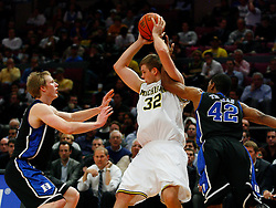 Nov 21, 2008; New York, NY, USA; Michigan Wolverines forward Zack Gibson (32) is fouled by Duke Blue Devils forward Lance Thomas (42) during the 2K Sports Classic Championship game at Madison Square Garden. Duke won 71-56.