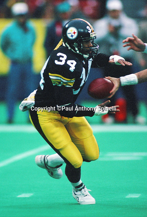 Pittsburgh Steelers running back Leroy Thompson (14) takes a handoff during the NFL football game against the Houston Oilers on Dec. 19, 1993 in Pittsburgh. The Oilers won the game 26-17. (©Paul Anthony Spinelli)