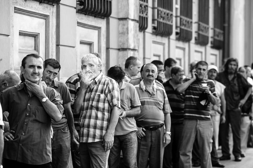 Men wait in line during Rammadan in Istanbul.