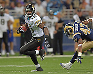 Jacksonville wide receiver Ernest Wilford (19) picks up 28-yards, after getting by St. Louis safety Jerome Carter (42) in the first half at the Edward Jones Dome in St. Louis, Missouri, October 30, 2005.  The Rams beat the Jaguars 24-21.