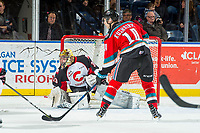 KELOWNA, CANADA - NOVEMBER 29: Isaiah DiLaura #33 of the Prince George Cougars defends the net as Wil Kushniryk #14 of the Kelowna Rockets looks for the pass on November 29, 2017 at Prospera Place in Kelowna, British Columbia, Canada.  (Photo by Marissa Baecker/Shoot the Breeze)  *** Local Caption ***
