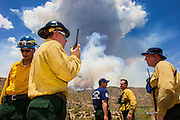 22 JUNE 2005 - CAVE CREEK, AZ:   Firefighters watch smoke billows up from the Cave Creek Complex, a large wild fire which burned northeast of Phoenix. The Cave Creek Complex fire was the third largest wildfire in the state of Arizona to date, after the Rodeo-Chediski fire and Wallow Fire. The fire started on June 21, 2005 by a lightning strike during a monsoon storm and burned 243,950 acres (987.2 km2).   PHOTO BY JACK KURTZ