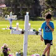 Memorial vigil for the 17 people killed at Marjory Stoneman Douglas High School by Nikolas Cruz using a semiautomatic AR-15 rifle. Mourners visit the 17 white crosses standing in a field in memory of each victim, 14 students and 3 faculty members. <br />