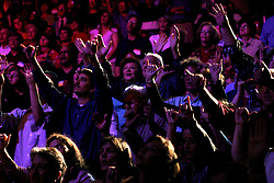 March 12th 2006. New Orleans, Louisiana. <br /> Praising the Lord. A capacity crowd prays, raises hands to God and waits for the Rev Billy Graham to take the stage. Claiming this to be his last event preaching from the pulpit, the world's most famous evangelist, The Reverend Billy Graham later addressed a capacity crowd at the New Orleans Arena as he brings his 'Celebration of Hope' weekend event to an end.<br /> Photo©; Charlie Varley/varleypix.com