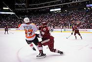 Dec. 3 2011; Glendale, AZ, USA; Phoenix Coyotes defensemen Adrian Aucoin (33) flips Philadelphia Flyers forward Maxime Talbot (27)during the second period at Jobing.com Arena. Mandatory Credit: Jennifer Stewart-US PRESSWIRE