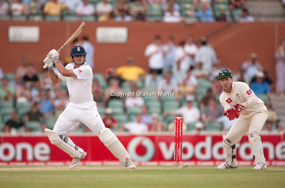 Alastair Cook bats during his century with a four off Xavier Doherty past wicket keeper Brad Haddin in the second Ashes Test Match between Australia and England at the Adelaide Oval. Photo: Graham Morris (Tel: +44(0)20 8969 4192 Email: sales@cricketpix.com) 4/12/10
