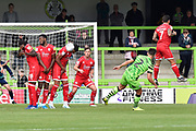 Mason Bloomfield (16) of Crawley Town blocks a free kick from Liam Shephard (2) of Forest Green Rovers during the EFL Sky Bet League 2 match between Forest Green Rovers and Crawley Town at the New Lawn, Forest Green, United Kingdom on 5 October 2019.