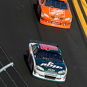 Sprint Cup Series driver Dale Earnhardt Jr. (88) and Sprint Cup Series driver Joey Logano (20)during the Daytona 500 Sprint Cup Race at Daytona International Speedway on February 20, 2011 in Daytona Beach, Florida. (AP Photo/Alex Menendez)