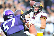 FORT WORTH, TX - SEPTEMBER 13:  Chris Streveler #5 of the Minnesota Golden Gophers drops back to pass against the TCU Horned Frogs on September 13, 2014 at Amon G. Carter Stadium in Fort Worth, Texas.  (Photo by Cooper Neill/Getty Images) *** Local Caption *** Chris Streveler