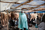 "A man speaks to the people, guests of an early marriage's celebration. Nationwide, 60 percent of girls younger than 18 are married and in the Amhara region, half of girls younger than 15 are married. North West of Ethiopia, on friday, Febrary 13 2009.....In a tangled mingling of tradition and culture, in the normal place of living, in a laid-back attitude. The background of Ethiopia's ""child brides"", a country which has the distinction of having highest percentage in the practice of early marriages despite having a law that establishes 18 years as minimum age to get married. Celebrations that last days, their minds clouded by girls cups of tella and the unknown for the future. White bridal veil frame their faces expressive of small defenseless creatures, who at the age ranging from three to twelve years shall be given to young brides men adults already...To protect the identities of the recorded subjects names and specific places are fictional."