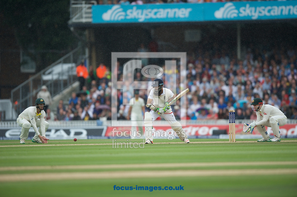 Moeen Ali of England batting in the rain during the 5th Investec Ashes Test match at the Kia Oval, London<br /> Picture by Alan Stanford/Focus Images Ltd +44 7915 056117<br /> 23/08/2015