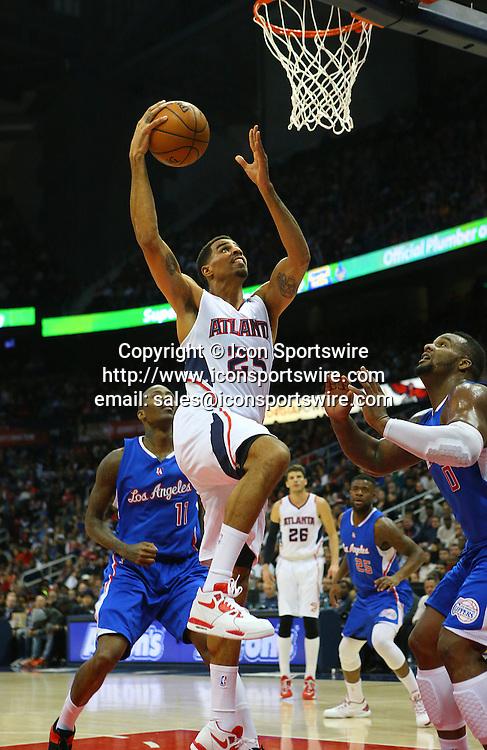 Dec. 23, 2014 - Atlanta, GA, USA - The Atlanta Hawks' Thabo Sefolosha (25) gets past the Los Angeles Clippers' Jamal Crawford at Philips Arena in Atlanta on Monday, Dec. 23, 2014