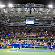 2019 US Open Tennis Tournament- Day Nine. A general view of  Roger Federer of Switzerland serving against Grigor Dimitrov of Bulgaria in the Men's Singles Quarter-Finals match on Arthur Ashe Stadium during the 2019 US Open Tennis Tournament at the USTA Billie Jean King National Tennis Center on September 3rd, 2019 in Flushing, Queens, New York City.  (Photo by Tim Clayton/Corbis via Getty Images)
