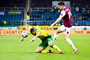 Norwich City midfielder Onel Hernández (11) fouled by Burnley midfielder Ashley Westwood (18)  during the The FA Cup match between Burnley and Norwich City at Turf Moor, Burnley, England on 25 January 2020.