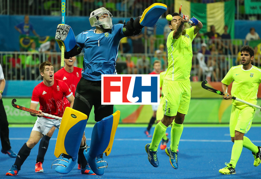 RIO DE JANEIRO, BRAZIL - AUGUST 09:  Goalkeeper Thiago Bomfim #1 of Brazil makes a save on a shot during the hockey game against Great Britain on Day 4 of the Rio 2016 Olympic Games at the Olympic Hockey Centre on August 9, 2016 in Rio de Janeiro, Brazil.  (Photo by Christian Petersen/Getty Images)
