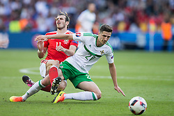 PARIS, FRANCE - Saturday, June 25, 2016: Wales' xxxx in action against Northern Ireland's Craig Cathcart during the Round of 16 UEFA Euro 2016 Championship match at the Parc des Princes. (Pic by Paul Greenwood/Propaganda)