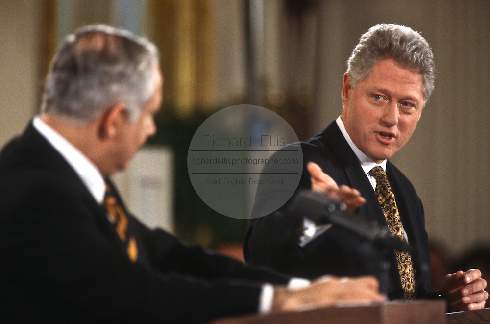 US President Bill Clinton points to Israeli Prime Minister Benjamin Netanyahu during a joint press conference February 13, 1997 In Washington, DC.