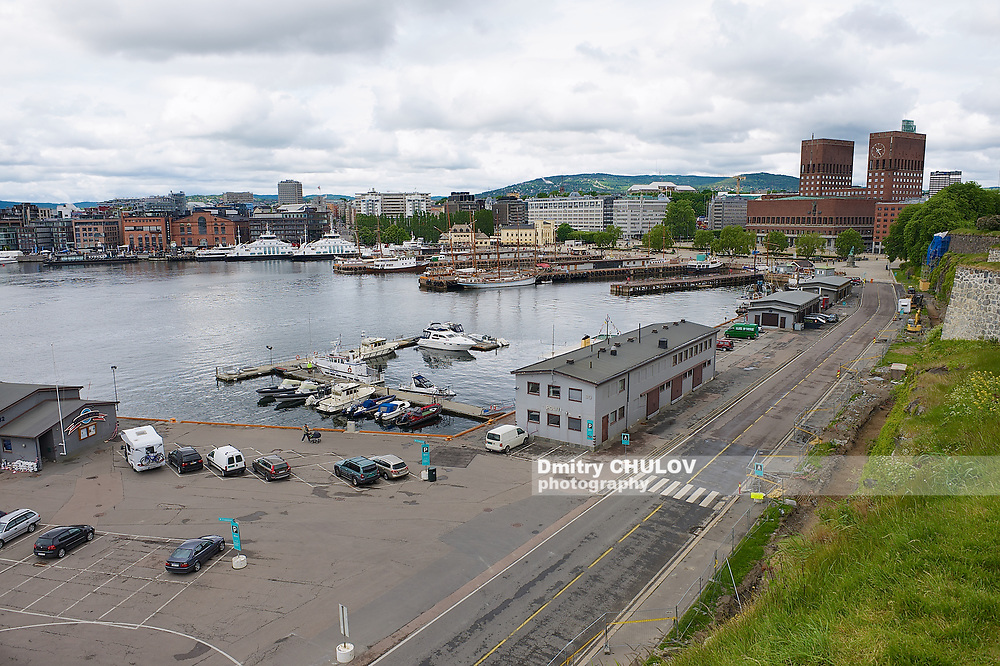 OSLO, NORWAY - JUNE 03, 2012: View to the harbor and Oslo city hall building in Oslo, Norway.