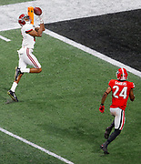 ATLANTA, GA - JANUARY 08: DeVonta Smith #6 of the Alabama Crimson Tide catches a 41 yard touchdown pass to beat the Georgia Bulldogs in the CFP National Championship presented by AT&T in overtime at Mercedes-Benz Stadium on January 8, 2018 in Atlanta, Georgia. (Photo by Mike Zarrilli/Getty Images)