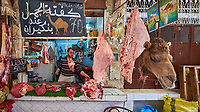 Camel Butcher Shop in the Medina of Fez. Image taken with a Fuji X-T1 camera and Zeiss 12 mm f/2.8 lens (ISO 200, 12 mm, f/2.8, 1/70 sec).