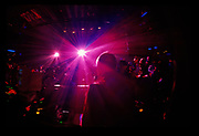 BACK OF DAVE SEAMAN FROM DJ BOOTH WITH RED LASERS