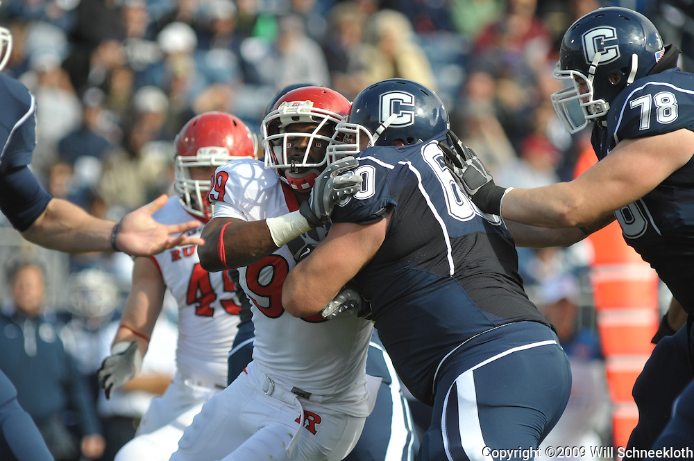 Oct 31, 2009; East Hartford, CT, USA; Rutgers defensive end Jonathan Freeny (99) battles Connecticut guard Erik Kuraczea (60) during first half Big East NCAA football action between Rutgers and Connecticut at Rentschler Field.