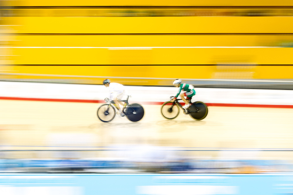 Diana Maria Garcia Orrego of Colombia leads Franny Fong of Mexico in the women's cycling sprint race at the 2015 Pan American Games in Toronto, Canada, July 19,  2015.  AFP PHOTO/GEOFF ROBINS