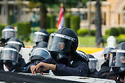 01 DECEMBER 2013 - BANGKOK, THAILAND: Thai riot police wait for anti-government protestors in front of Government House in Bangkok. Thousands of anti-government Thais confronted riot police at Phanitchayakan Intersection, where Rama V and Phitsanoluk Roads intersect, next to Government House (the office of the Prime Minister). Protestors threw rocks, cherry bombs, small explosives and Molotov cocktails at police who responded with waves of tear gas and chemical dispersal weapons. At least four people were killed at a university in suburban Bangkok when gangs of pro-government and anti-government demonstrators clashed. This is the most serious political violence in Thailand since 2010.    PHOTO BY JACK KURTZ