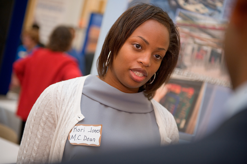 19082Fall Career Fair in Baker Center 10/08/08..Kori Jones, M.C. Dean Inc. talks to Praveen Ravula