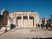 Israel Capernaum ancient Jewish synagogue and city ruins. archaeological remains of the beautiful White Synagogue at Capernaum, now partially reconstructed, made of dressed stones. Many decorative fragments once ornamented its facade. Presumably, this was a traditional Jewish synagogue probably dating from the late third century.