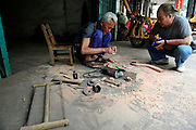LIUZHOU, CHINA - MAY 19: (CHINA OUT) <br /> <br /> Wooden Three-wheeled Vehicle<br /> <br /> Wei Guirong works on components for his three-wheeled vehicle on May 19, 2014 in Liuzhou, Guangxi Province of China. Wei Guirong, 66, has made three wooden three-wheeled vehicles for grandchildren, and the vehicles are made entirely from wood, apart from the engine, wheels and some electronic parts. He was in charge of maintaining agricultural machinery when he was younger. <br /> ©Exclusivepix