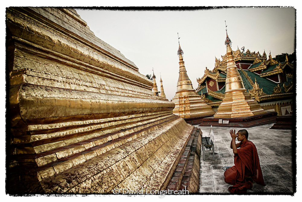 "In this ""Signature Series"" image by David Longstreath, devotees and the faithful gather at the Swedagon pagoda in Rangoon, Burma. The Swedagon is Burma's most holy sight and is visited by thousand of Burmese each day."