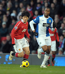 Ji-Sung Park (Man Utd) and Herold Goulon (Blackburn) during the Barclays Premier League match between Manchester United and Blackburn Rovers at Old Trafford on November 27, 2010 in Manchester, England.
