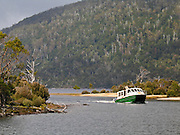 The Ida Clair ferries bushwalkers from Cynthia Bay to Narcissus Point across Lake Saint Clair to the Overland Track in Cradle Mountain-Lake St Clair National Park, Tasmania, Australia. Lake St Clair is Australia's deepest high altitude lake. The Tasmanian Wilderness was honored as a UNESCO World Heritage Site in 1982, expanded in 1989.