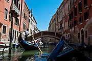 Tourists enjoy a gondola ride in Venice, Italy. (Sam Lucero photo)